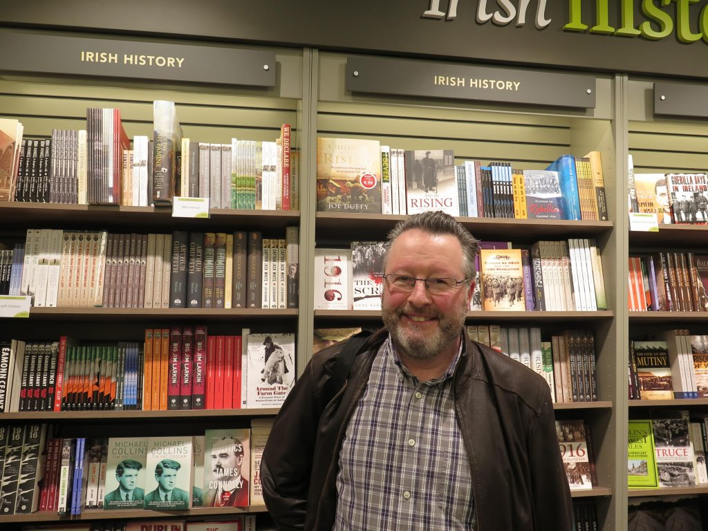 Paul Gorry in a book shop smiling