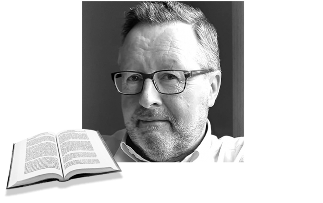 Paul headshot in black and white with open book