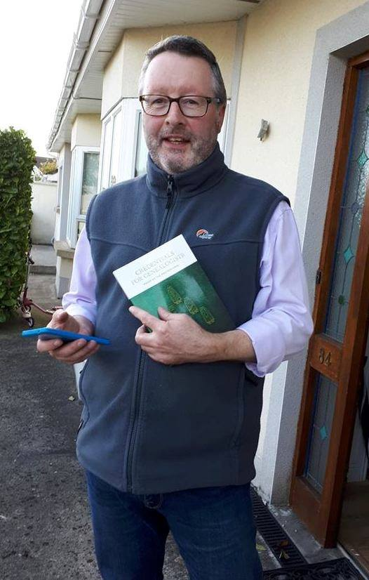 Paul smiling with a copy of credentials book