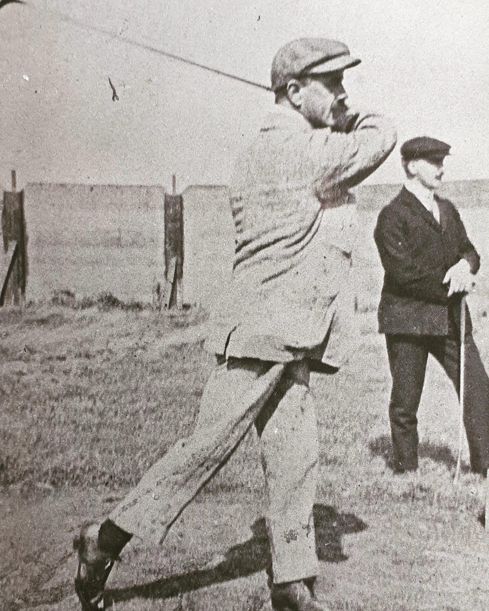 Unnamed golfer vintage photo of a golfer with a cap swinging a club